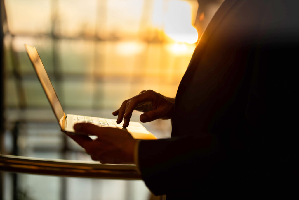 Woman with computer in sunlight